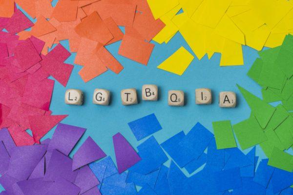 lgbtqia-word-cubes-heaps-paper-gay-colors_23-2148120300